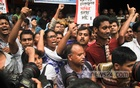 Tuba Group workers, on a hunger strike for the past six days demanding their unpaid salaries, took to the street in front of Hossain Market in Badda on Saturday. Photo: asif mahmud ove/ bdnews24.com
