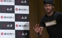 Brazilian football player and Barcelona forward Neymar walks into a news conference in Tokyo July 31, 2014. Reuters