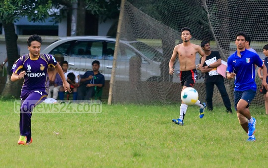 Trying his luck in football? Ace Bangladesh all-rounder Shakib Al Hasan playing with people at a local sports ground in Dhaka as he serves his six-month ban for a breach of rules. Photo: mustafiz mamun/ bdnews24.com