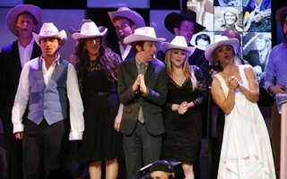 Cast members of ''The Big Bang Theory'' take the stage along with others to end the night wearing cowboy hats in honor of country music singer Glen Campbell during the 22nd annual ''A Night at Sardi's'' to benefit the Alzheimer's Association at the Beverly Hilton Hotel in Beverly Hills, California, March 26, 2014. Reuters