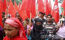 National Garments Workers Federation takes out a march in front of the National Press Club on Saturday demanding Helicon Garments at Dhaka EPZ be reopened. Photo: asif mahmud ove/ bdnews24.com