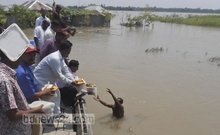 Nilphamari district administration on Wednesday distributes relief among victims of floods that have affected the entire northern region of Bangladesh. Photo: bdnews24.com