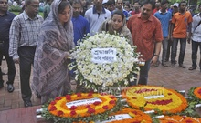 Members of national poet Kazi Nazrul Islam's family offer prayers at his grave to mark his 38th death anniversary on Wednesday. Photo: bdnews24.com