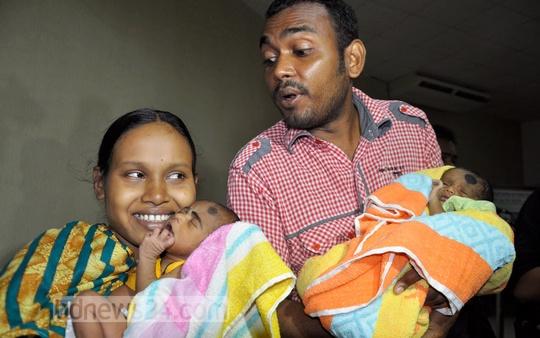 Ekhlas is returned to his mother Runa Akhtar eight days after he was stolen. Father Kaosar Hossain holds his twin, Yasin. Photo: bdnews24.com
