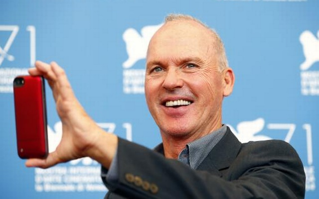 U.S. actor Michael Keaton poses during the photo call for the movie Birdman or (The unexpected virtue of ignorance) at the 71st Venice Film Festival August 27, 2014. Reuters