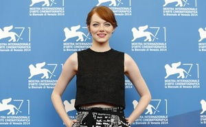 U.S. actress Emma Stone poses during the photo call for the movie Birdman or (The unexpected virtue of ignorance) at the 71st Venice Film Festival August 27, 2014. Reuters