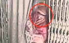 Picture shows Parvin with the missing baby on Aug 20, the day before the theft. Picture taken from CCTV footage of the hospital aired on Somoy TV.