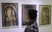 A visitor at a pen art exhibition by four artists at the Manobhumi Art Gallery on Elephant Road on Friday. Photo: asif mahmud ove/ bdnews24.com