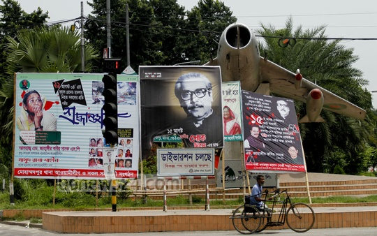 The plane on Bijoy Sarani is hidden behind a cloud of political messages. Photo: tanvir ahammed/ bdnews24.com