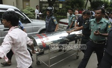 The body of war crimes convict Abdul Alim is being carried out of the prison ward at Bangabandhu Sheikh Mujib Medical University Hospital where he died on Saturday. Photo: nayan kumar/ bdnews24.com