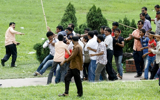 A fight breaks out among a group of BNP supporters during a ceremony at the mausoleum of party founder Ziaur Rahman on the occasion of BNP's 36th founding anniversary on Monday. Photo: tanvir ahammed/ bdnews24.com