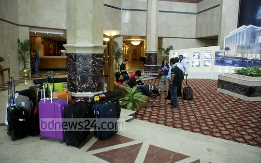 Guests leave the Ruposhi Bangla Hotel which closed on Monday for renovations that are to be spread over the next 18 months. Photo: bdnews24.com