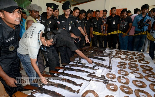 Small arms and ammunition unearthed from Sylhet's Satchharhi forests put on display at RAB-9's Srimangal camp on Tuesday. Photo: bdnews24.com