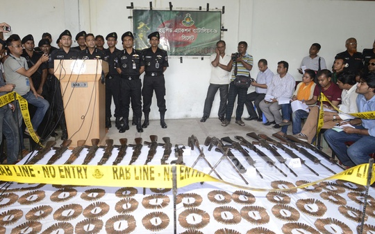 RAB's Media Wing Director Mufti Mahmud Khan briefs reporters on the weapons and ammunition haul at Srimangal RAB 9 camp around noon on Tuesday; the seized arms are on display. Photo: bdnews24.com