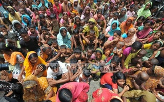 Assam riot victims wait for relief supplies outside a camp in this 2012 file photo.