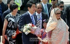 Prime Minister Sheikh Hasina receives Japanese Prime Minister Shinzo Abe and his wife Akie Abe at Hazrat Shahjalal International Airport in Dhaka on Saturday. Photo: bdnews24.com