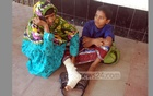 A boy with a broken leg and his mother wait at a corridor at Mitford hospital to recieve treatment during a strike of the interns on Sunday.  Photo: bdnews24.com