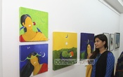 A visitor at a painting exhibition 'Shreyoshi' s at Gallery Twenty One in Dhaka on Friday. Photo: nayan kumar/ bdnews24.com