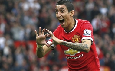 Manchester United's Angel Di Maria celebrates after scoring a goal against Queens Park Rangers during their English Premier League football match at Old Trafford in Manchester, northern England September 14, 2014. Reuters