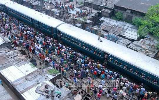 Railway authorities demolish illegal establishments along railway tracks at Dhaka's Nakhalpara on Tuesday. Photo: bdnews24.com