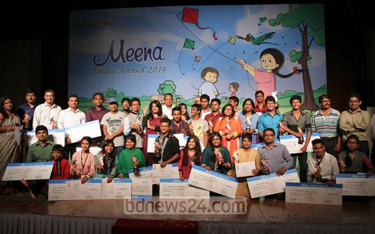 UNICEF's Meena Media award winners pose for photographs after receiving their prizes at Hotel Sonargaon in Dhaka on Tuesday. Photo: nayan kumar/ bdnews24.com