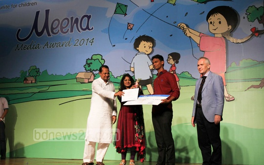 Information Minister Hasanul Haque Inu and UNICEF Goodwill Ambassador Arifa Zaman Moushumi hand over the Meena Media Award to child journalist Monir Hossain at the Sonargaon Hotel on Tuesday. Photo: nayan kumar/ bdnews24.com