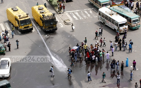 Police lobbed tear gas and shot hot water from water cannons to disperse Ganajagaran Mancha activists as they protested against the Supreme Court's verdict on Wednesday. Photo: nayan kumar/ bdnews24.com