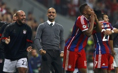 Bayern Munich's Jerome Boateng (R) celebrates with coach josep Guardiola (C) after scoring a goal against Manchester City during their Champions League group E football match in Munich September 17, 2014. Reuters