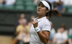 Li Na of China reacts after defeating Paula Kania of Poland in their women's singles tennis match at the Wimbledon Tennis Championships, in London June 23, 2014. Reuters