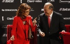 Italian actress Sophia Loren (L) jokes with Mexican tycoon Carlos Slim after cutting the ribbon for her exhibition at the Soumaya museum in Mexico City Sept 18, 2014. Credit: Reuters