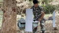 A Lebanese Army soldier carries an Israeli drone in the Marjeyoun countryside, south Lebanon September 20, 2014. Reuters