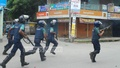 Jamaat-e-Islami supporters clash with police in Rajshahi from a procession to demand the release of senior leader and war criminal Delwar Hossain Sayedee on Saturday. Photo: Gulbar Ali Juwel/ bdnews24.com