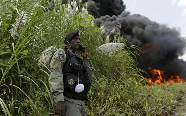 A police officer stands guard as confiscated drugs are incinerated in Panama City September 19, 2014. Reuters