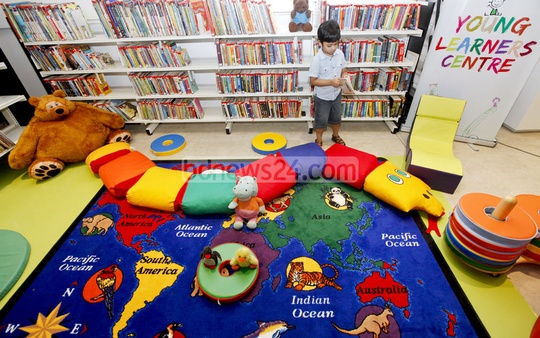 A child looks at a book at the Young Learners Centre at the British Council's new and refurbished library that was inaugurated on Saturday. Photo: asaduzzaman pramanik/ bdnews24.com