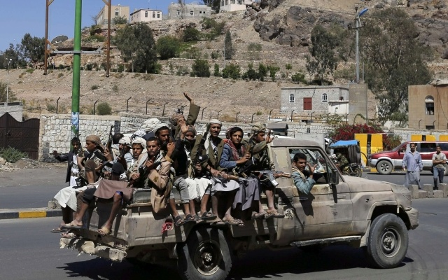 Shia rebels ride on a truck outside the state television compound in Sanaa September 21, 2014. REUTERS