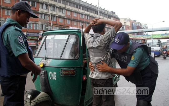 Police search commuters at Kalyanpur to prevent vandalism during Jamaat-e-Islami's countrywide shutdown for the release of war criminal Delwar Hossain Sayedee on Sunday. Photo: asif mahmud ove/ bdnews24.com