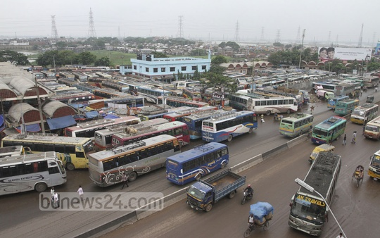 Buses stand idle at Gabtoli Bus Terminal in fear of vandalism during the countrywide shutdown called by the Jamaat-e-Islami for release of war criminal Delwar Hossain Sayedee on Sunday. Photo: nayan kumar/ bdnews24.com