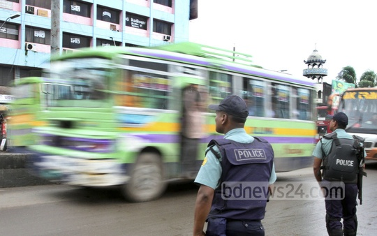 Policemen stand guard at Gabtoli during the countrywide shutdown called by Jamaat-e-Islami on Sunday in a bid to mount pressure for the release of top party leader and war criminal Delwar Hossain Sayedee. Photo: nayan kumar/ bdnews24.com