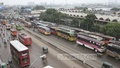 Hundreds of buses that operate between the districts stand idle at Gabtoli Bus Terminal during the countrywide shutdown called by Jamaat-e-Islami on Sunday. Photo: nayan kumar/ bdnews24.com