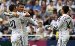 Real Madrid's Cristiano Ronaldo (C) celebrates his goal against Deportivo Coruna with his teammates James Rodriguez (L) and Chicharito during their Spanish First Division football match at the Riazor stadium in Coruna September 20, 2014. Reuters