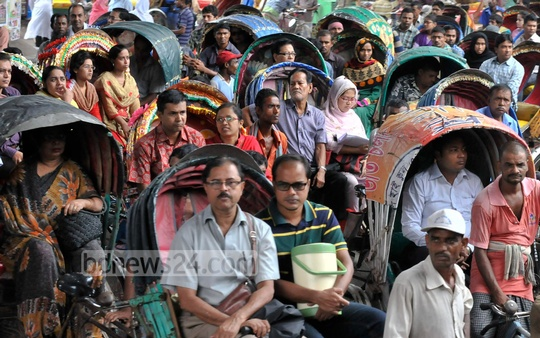 Rickshaws dominated Dhaka's streets during 20-party Alliance's nationwide general strike on Monday. Photo taken from Khilgaon. Photo taken at Hatirjheel on Monday shows the cityscape drenched by a sudden rain. Photo: asif mahmud ove/ bdnews24.com