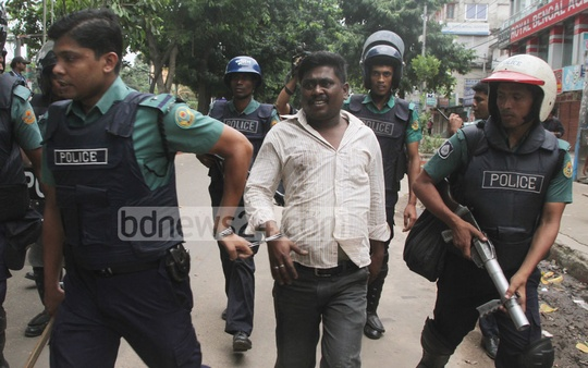 Police arrest a man in front of the BNP office in Chittagong as he was trying to vandalise a transport during 20-party Alliance's nationwide general strike on Monday. Photo: suman babu/ bdnews24.com
