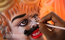 An artist is busy fixing the attire on an idol of goddess Durga at Dhaka's Shankharibazar on Friday ahead of Durga Puja, the biggest religious festival of the Hindus community. Photo: asif mahmud ove/ bdnews24.com