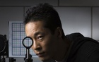 University of Rochester PhD student Joseph Choi demonstrates a cloaking device using four lenses in Rochester, New York in this Sept 11, 2014 University of Rochester handout photo. Credit: Reuters