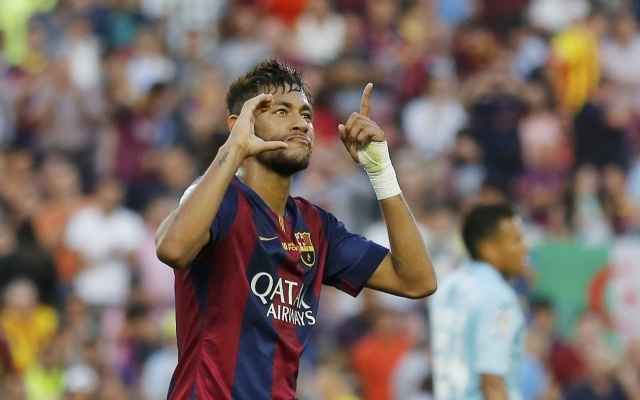 Barcelona's Neymar celebrates after scoring his hat-trick against Granada FC during their Spanish first division football match at Nou Camp stadium in Barcelona September 27, 2014. Reuters