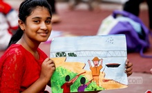 A child holds up her artwork after an art competition on the first day of the children's cultural festival at the Central Shaheed Minar on Monday. Photo: asaduzzaman pramanik/ bdnews24.com