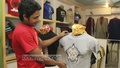 T-shirts themed on Durga Puja are the hot stuff at Dhaka's Aziz Super Market. Photo: nayan kumar/ bdnews24.com