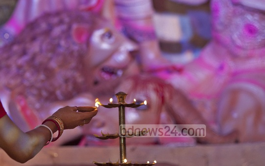 Durga Puja, the biggest Hindu festival in the country, begins with Bodhan, Adhivas and Shashthi on Tuesday. Photo taken from Kalabagan sports ground. Photo: bdnews24.com