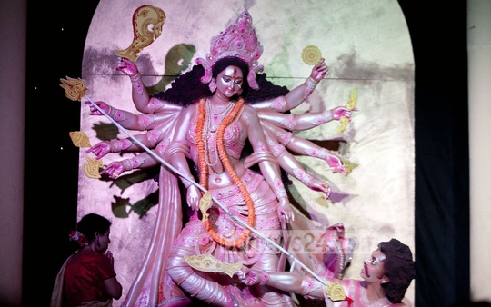 A devotee performs rituals in front of Goddess Durga at a Mandap in Dhaka's Kalabagan sports ground on Tuesday. Photo: bdnews24.com