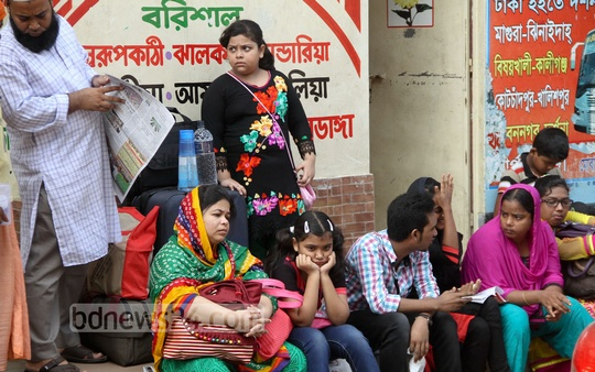 Passengers wait for buses at Gabtoli bus terminal on Thursday. Photo: asif mahmud ove/ bdnews24.com